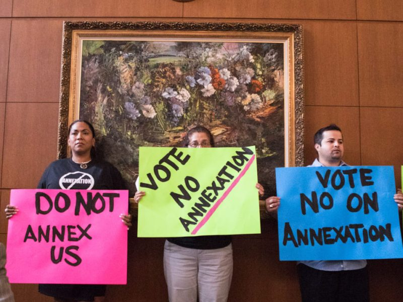 Area residents protest while San Antonio City Council considers an annexation plan.