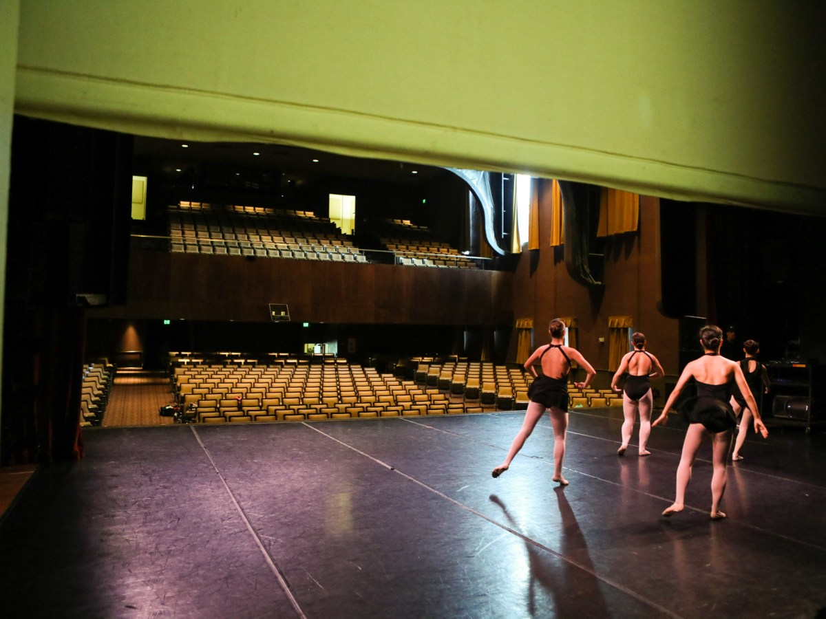 Dancers practice on the stage of the Jo Long Theatre during the Carver's Summer Dance Intensive Program in 2017. In 2004, the auditorium was named the Jo Long Theatre for the Performing Arts in honor of Long's work.