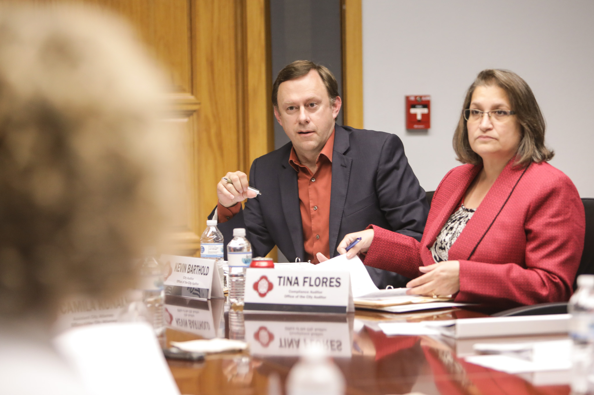Office of the City Auditor City Auditor Kevin Barthold (left) and Office of the City Auditor Compliance Auditor Tina Flores discuss a point in an Ethics Review Board meeting on July 11 in City Hall.