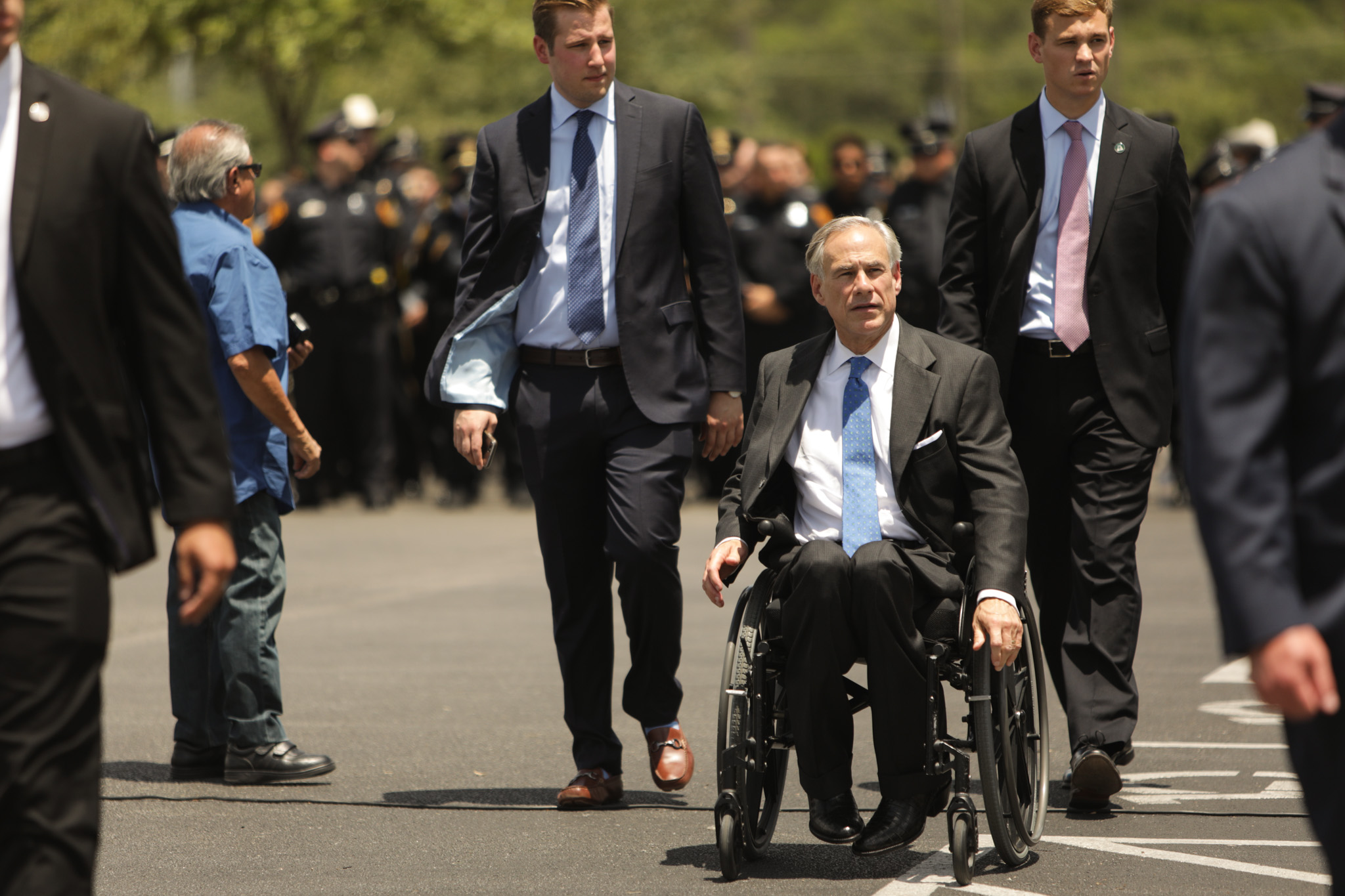 Governor Greg Abbott leaves after attending the ceremony in honor of fallen SAPD officer Miguel Moreno outside of Community Bible Church.