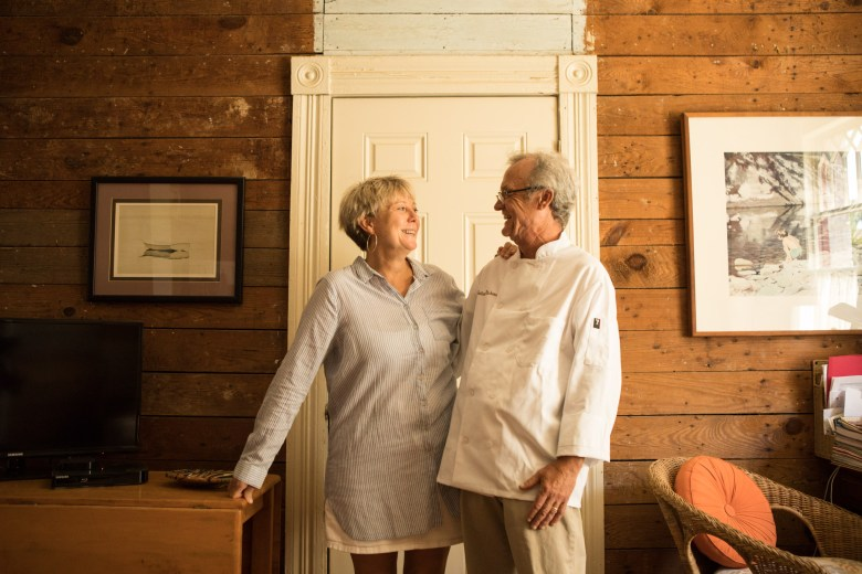 (From left) Outlaw Kitchens Co-Owners Peggy Howe and Paul Sartory stand in the living room of home attached to Outlaw Kitchens.