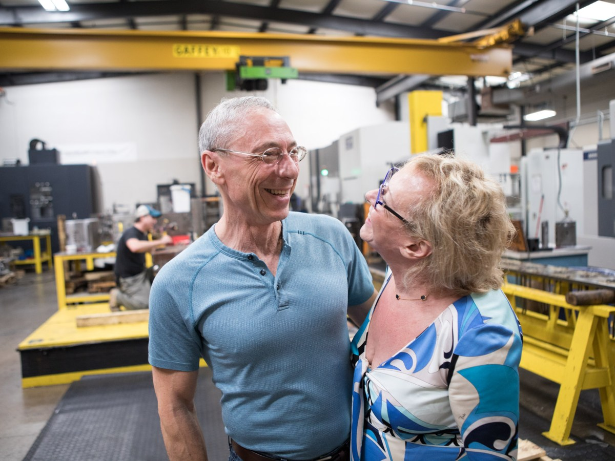 Precision Mold & Tool Group owners (from left) Naum and Maya Royberg share a laugh together in their facility.