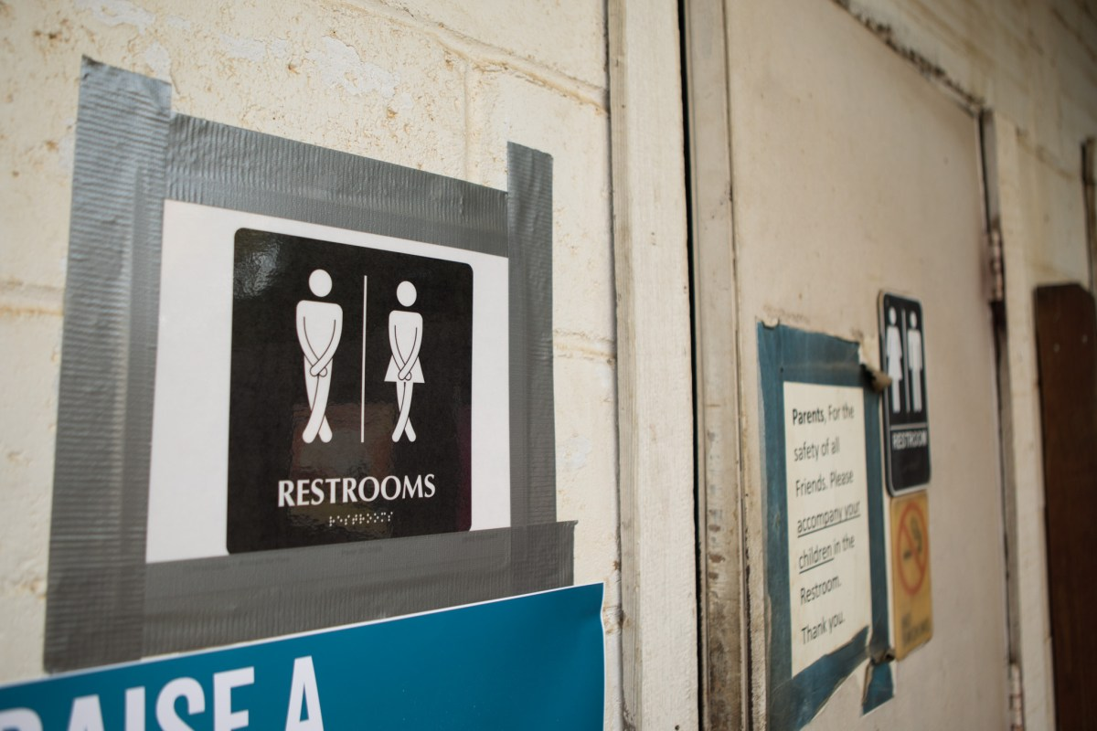 A sign outside the bathroom of The Friendly Spot promotes unisex bathrooms.