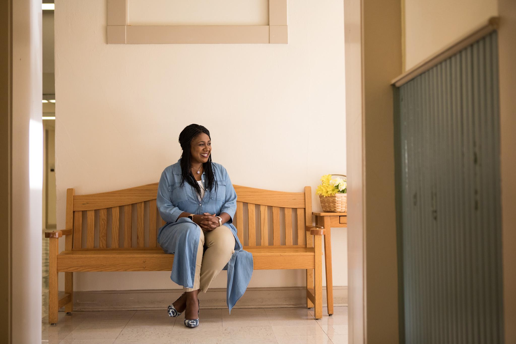 SAISD Chief of Staff Tiffany Grant sits inside the new Pickett Parent Center.