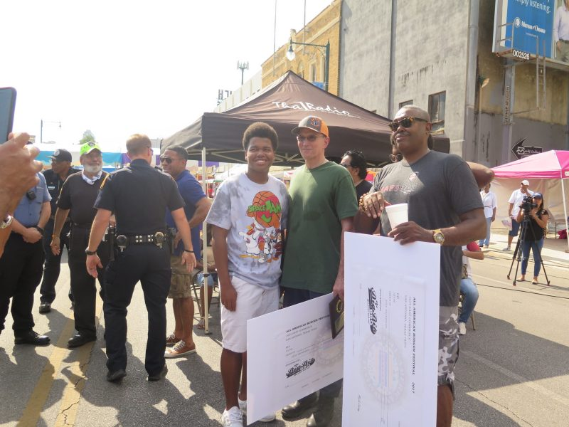 Police Chief William McManus (center) poses with San Antonio Fire Department Chief Charles Hood (right) after awards are given out at the third All-American Burger Festival.