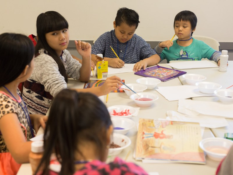 Students work on an art project during camp.