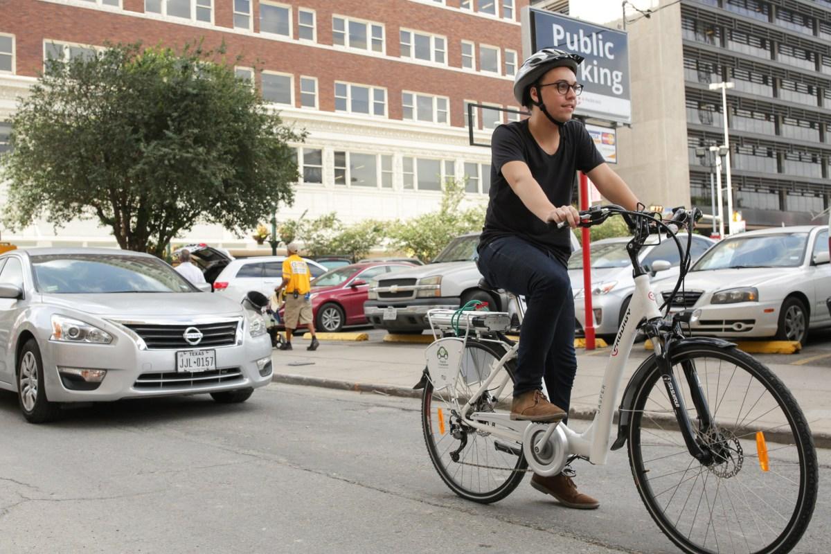 Daniel Conrad rides the electric assist bicycle through downtown San Antonio.