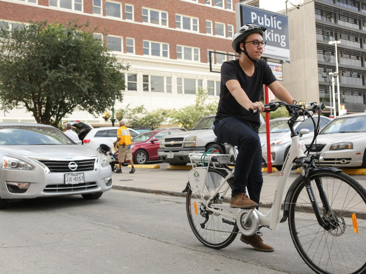Daniel Conrad rides the electric assist bicycle through downtown San Antonio.