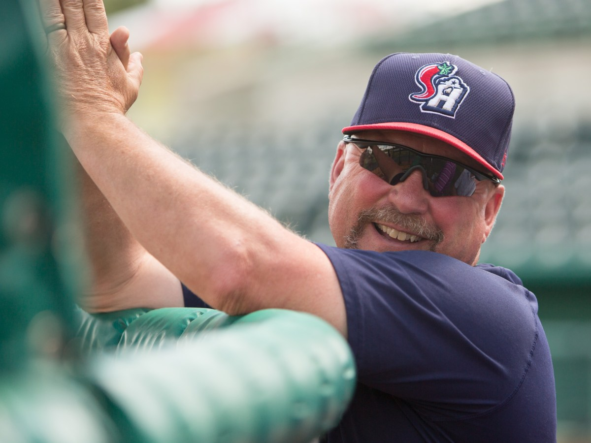 Missions Manager Phillip Wellman laughs during batting practice before a game on Thursday July 6th.