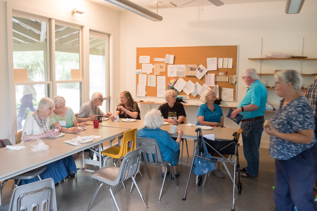 Members of the parish participate in a potluck in the community Room at the Quaker Meetinghouse.