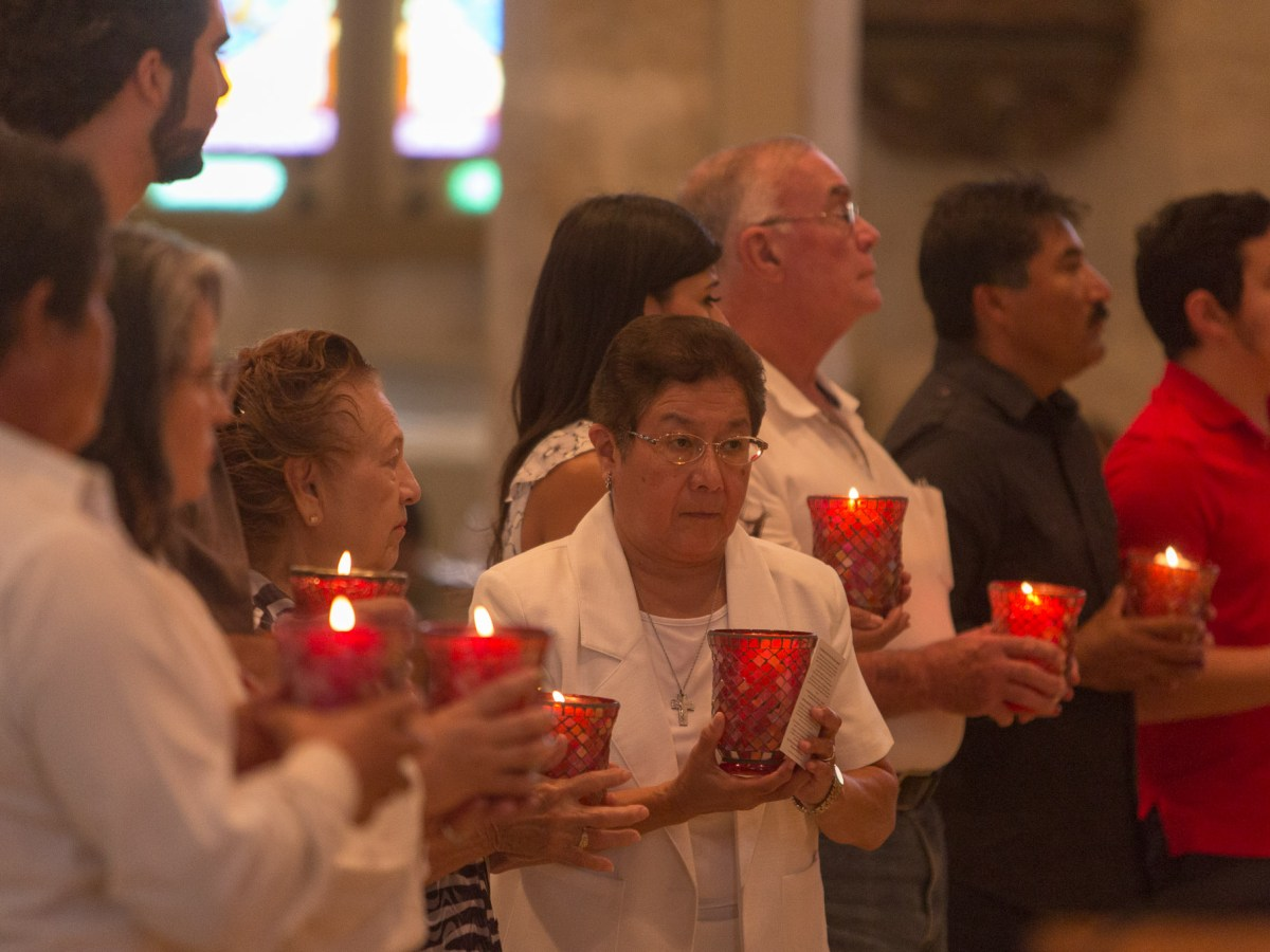 Candles were given to ten parishioner's in honor of the ten lives lost in the human smuggling crime that ended in San Antonio last week.