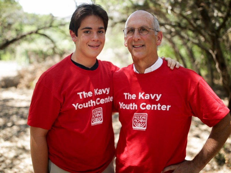Will (left) and Jeff Kavy pose for a photo at the future site of the Kavy Youth Center at Agudas Achim.