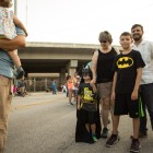 (From left) Connor, 4, Bridget Pawlik, Bryce, 10, and Joey Pawlik wait in line to take a photo with Batman at the 5th Annual Bat Loco Bash.