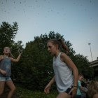 (From left) Cameron, 15, Lily, 10, and Hailey, 12, try to find the best angle to take a photo of the bats flying from the I-35 underpass at the 5th Annual Bat Loco Bash.