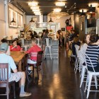 A large crowd gathers on the opening day of Boss Bagel.