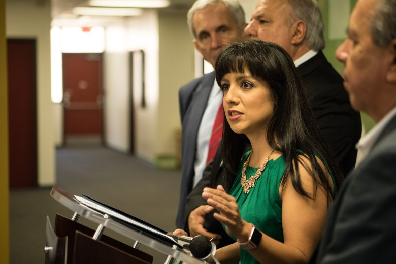 San Antonio Chamber of Commerce VP of Education/Workforce Development Priscilla Camancho speaks at The Children's Shelter regarding efforts to aid foster children and foster families who are displaced by Hurricane Harvey.