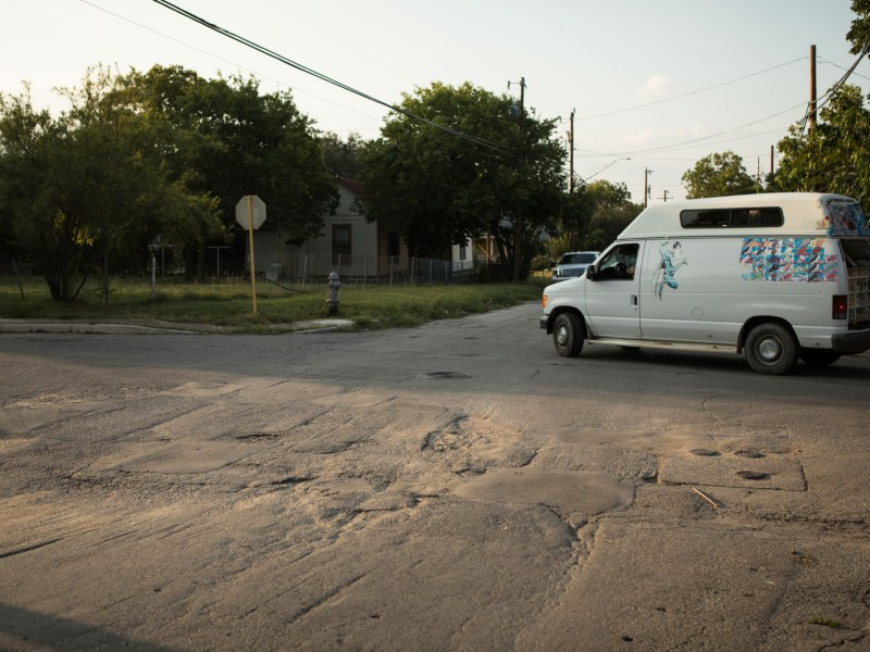 An ice cream truck drives on a street that could benefit from increased infrastructure spending the Eastside.