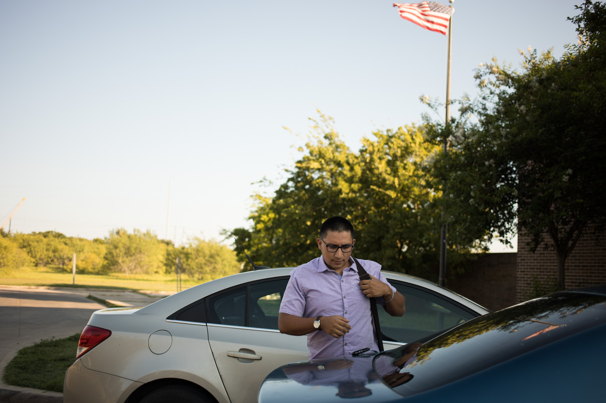 Diego Mancha Dominguez exits his car to walk toward the post office where he will send his information for his DACA renewal.