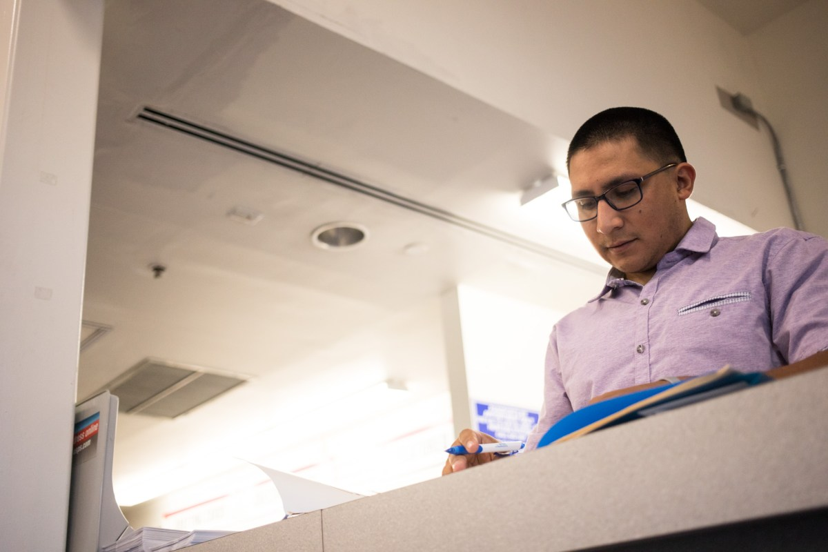 Diego Mancha Dominguez finalizes all his materials to send in for his DACA renewal at the post office.