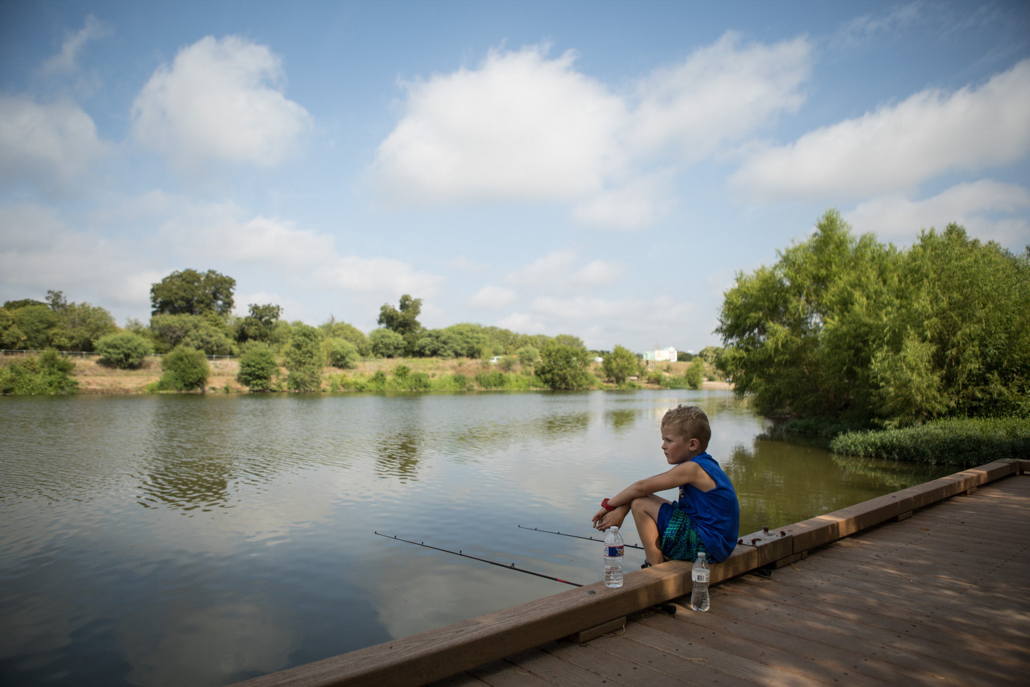 Corbin, 7, waits for a fish to bite at Family, Fishing and Friends at Acequia Park.