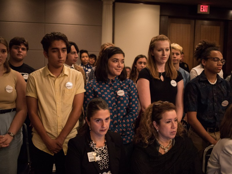 Students in the group Student Committee for Change stand upon introduction at a NEISD board meeting to discuss the possibility of changing the name of Robert E. Lee High School.