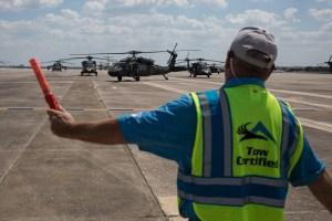 Atlantic Aviation General Manager Dwight Randolph directs a Black Hawk helicoptor landing from El Paso at Port San Antonio.