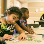 Marley, 4, and Tristan, 3, put puzzles together at the YMCA After School Care Program at the Sunshine Cottage School for Deaf Children.