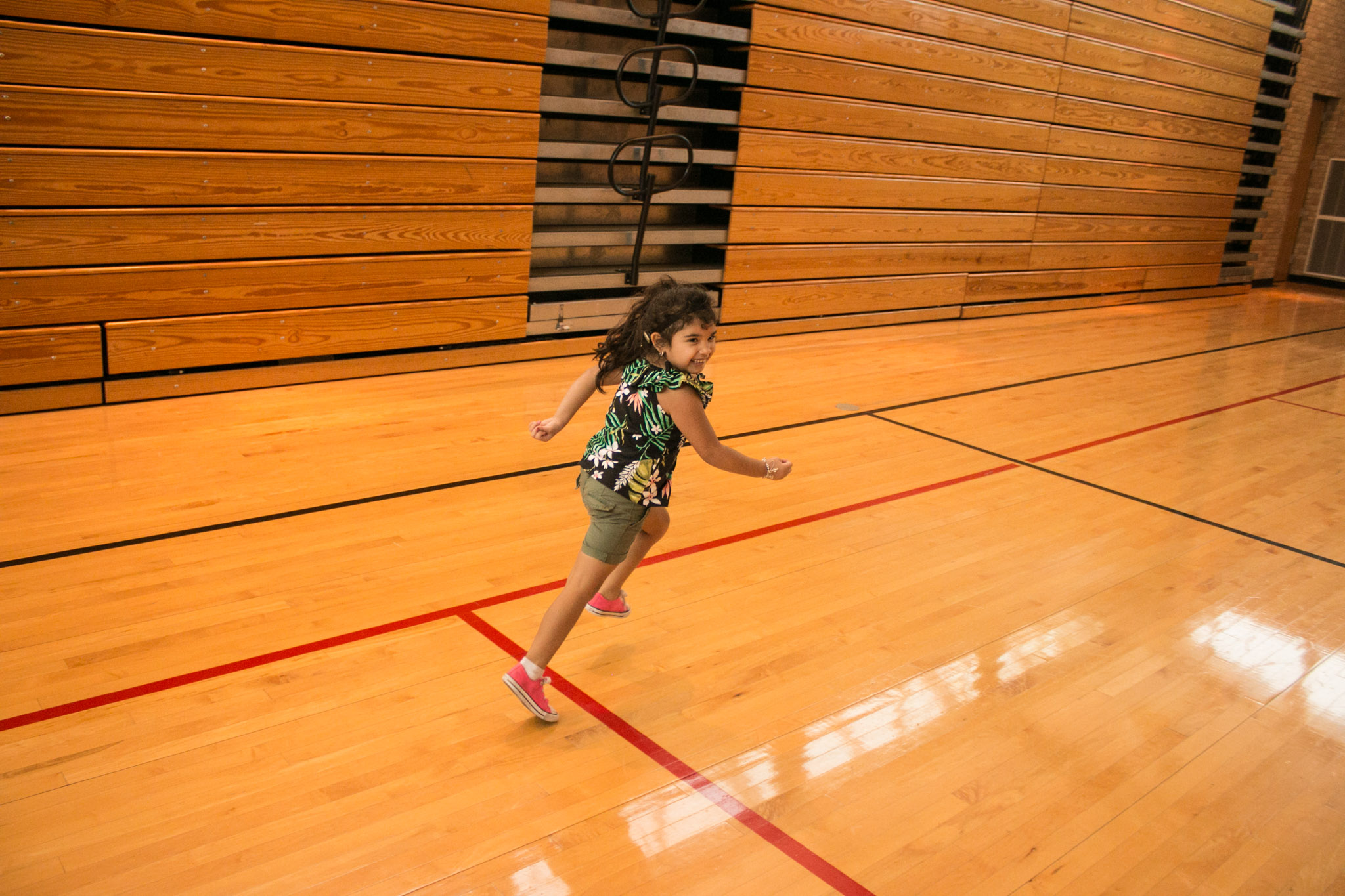 Marley, 4, imitates an airplane in the gym at the YMCA After School Care Program at the Sunshine Cottage School for Deaf Children.