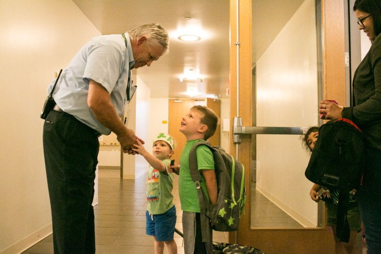 (From left) Sunshine Cottage School for Deaf Children Principal Jeffrey Bryan greets Aaron, 3, and Austin, 4, at the YMCA After School Care Program at the Sunshine Cottage School for Deaf Children.