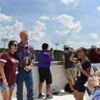 Gov. Bruce Rauner (R) poses for photos with attendees at SIU's Saluki Stadium.