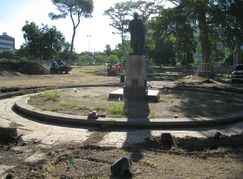 A brick pathway encircles the reflecting pool at Miraflores.