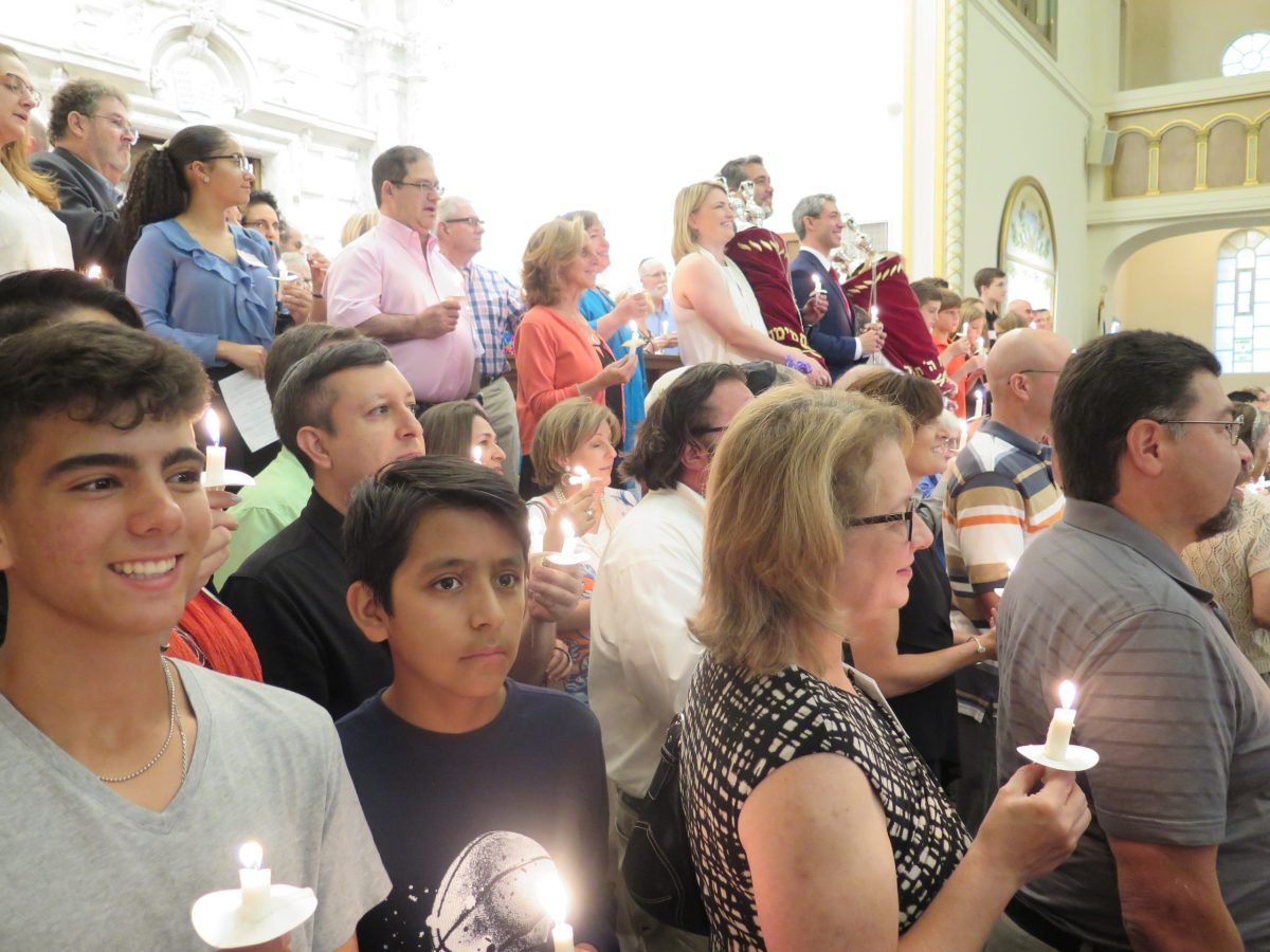 Congregants of Temple Beth-El participate in a candlelit vigil against Anti-Semitic hate.