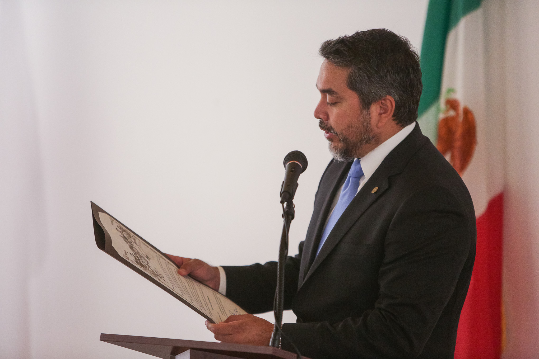 Councilman Roberto Treviño (D1) reads off a proclamation from Mayor Ron Nirenberg.