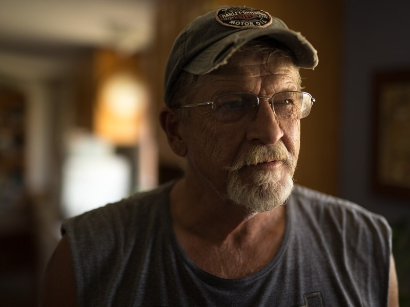 James Sammons stands in the living room, the same house he stayed in as a category 4 hurricane passed.
