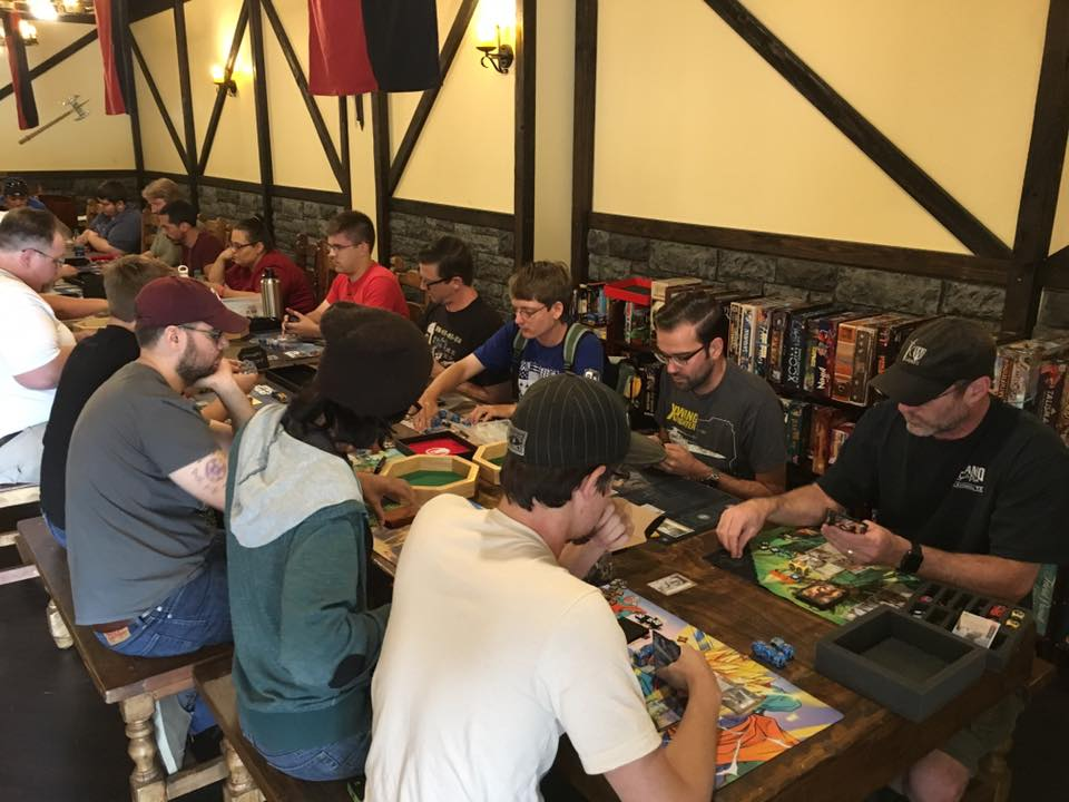 Gamers play a variety of table top games at Knight Watch Games.