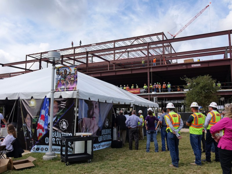 Working crews, students, and Texas A&M faculty witness the topping of a 63 million dollar STEM facility on Thursday, September 21.