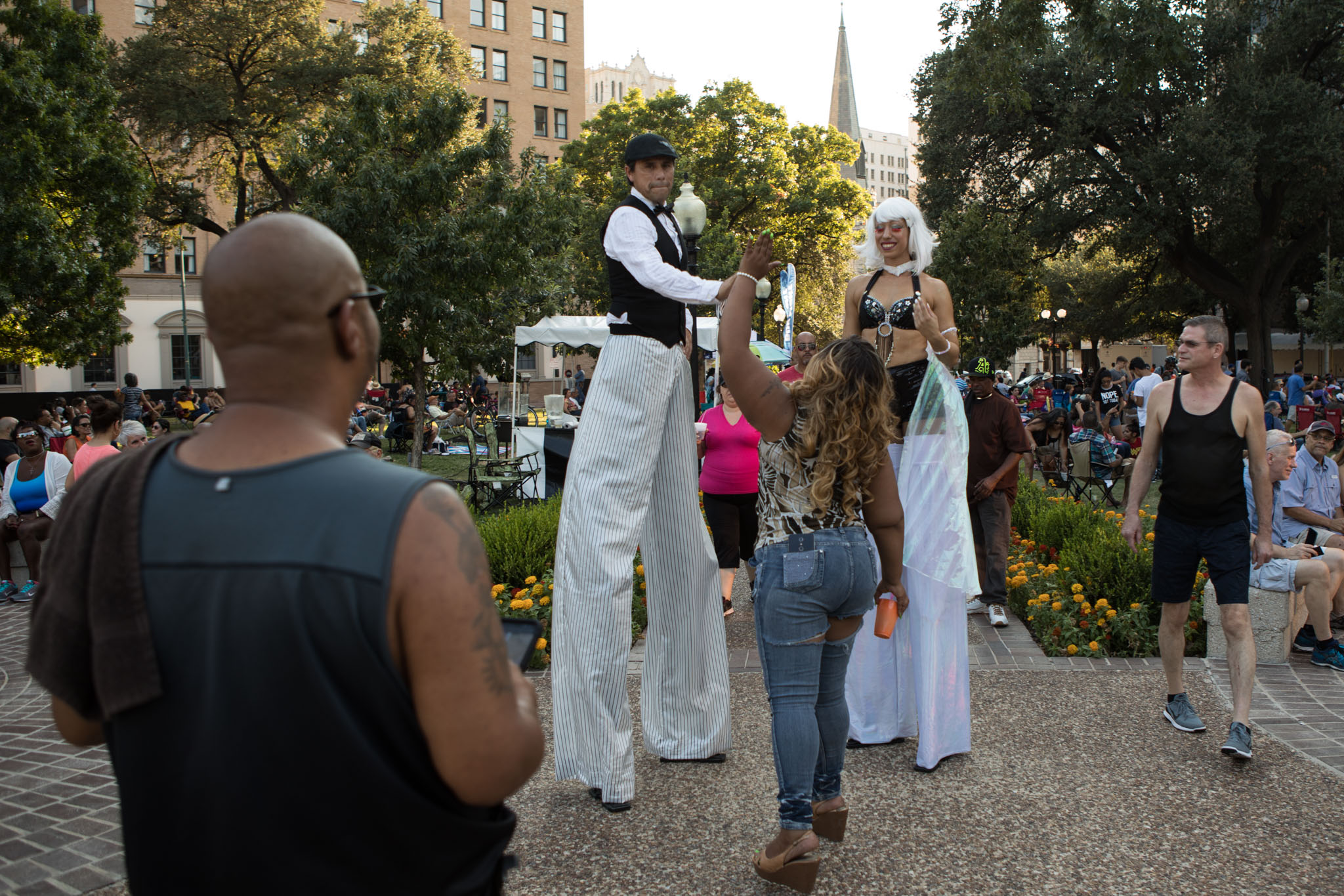 Monique Russell gives a high five to the Aqua Acro stilt walkers at Jazz'SALive 2017.
