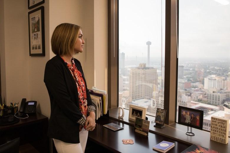 San Antonio EDF President & CEO Jenna Saucedo-Herrera stands in her new office in the new San Antonio Economic Development Foundation in the Weston Centre.