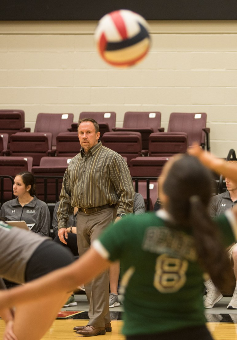Ronald Reagan High School Volleyball Coach Mike Carter watches a serve from one of his players.
