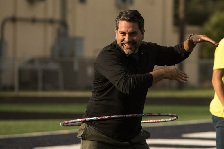 Councilman Roberto Treviño (D1) completes the hoola hoop portion of an exercise obstacle course at the Forward in Fitness program kickoff at Central Catholic High School.