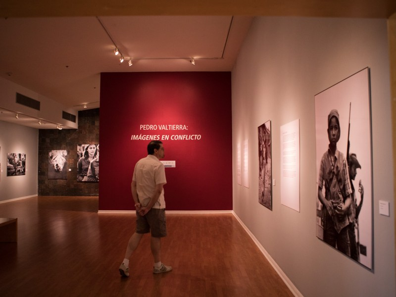 Paul Vaughn walks through the exhibition Pedro Valtierra: Imágenes en Conflicto in the Mexican Cultural Institute San Antonio.