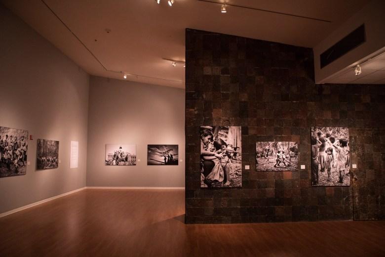 Images of Pedro Valtierra: Imágenes en Conflicto line the walls of the Mexican Cultural Institute San Antonio.