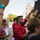 Juan Moreno (center) holds up his fist during the protest against SB4.