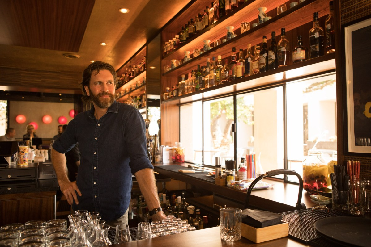 Owner Steve Mahoney stands behind the bar of Hanzo.