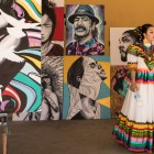 Ballet Folklorico Mestizo dancer Alexis Estrada looks at the work of Adrian De La Cruz before performing at Mission Pachanga.
