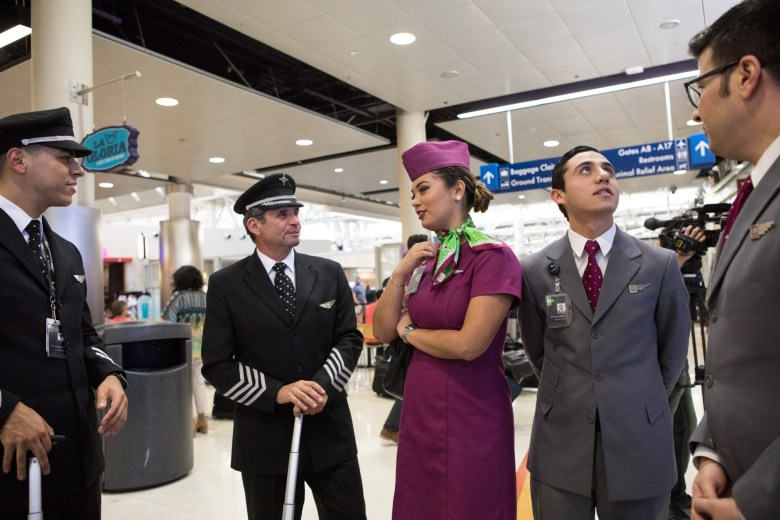 A Volaris flight crew chats before the first Volaris direct flight from San Antonio to Mexico City.