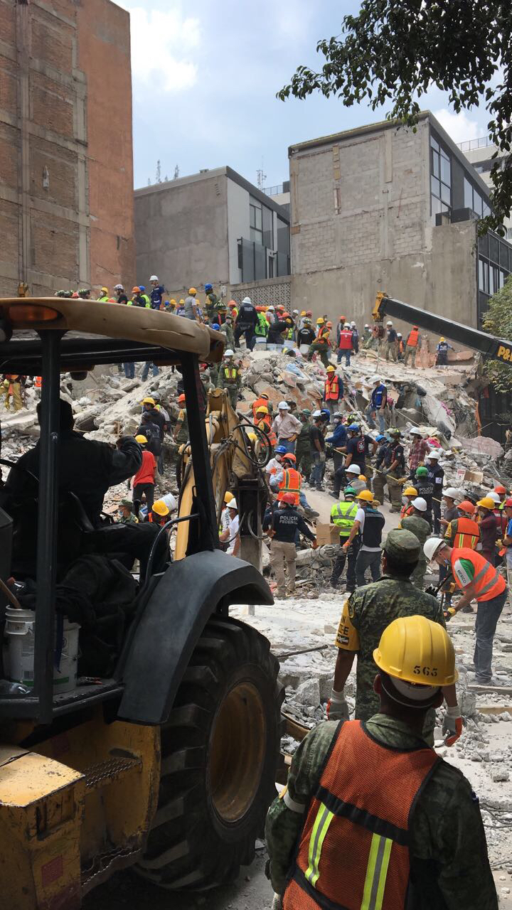 Workers begin recovery efforts after a 7.1-magnitude earthquake rocked Mexico City.