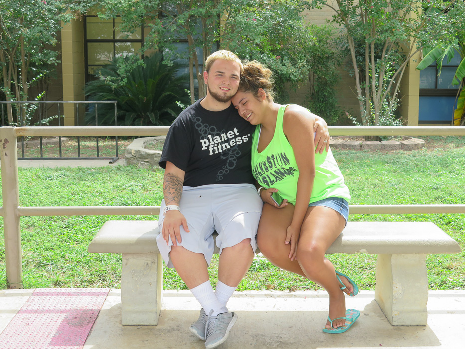 Alex and Alyssa Spero embrace outside the Red Cross shelter at Kazen Middle School.