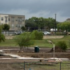 A future greenway trail is taking shape behind Kennedy Apartments.