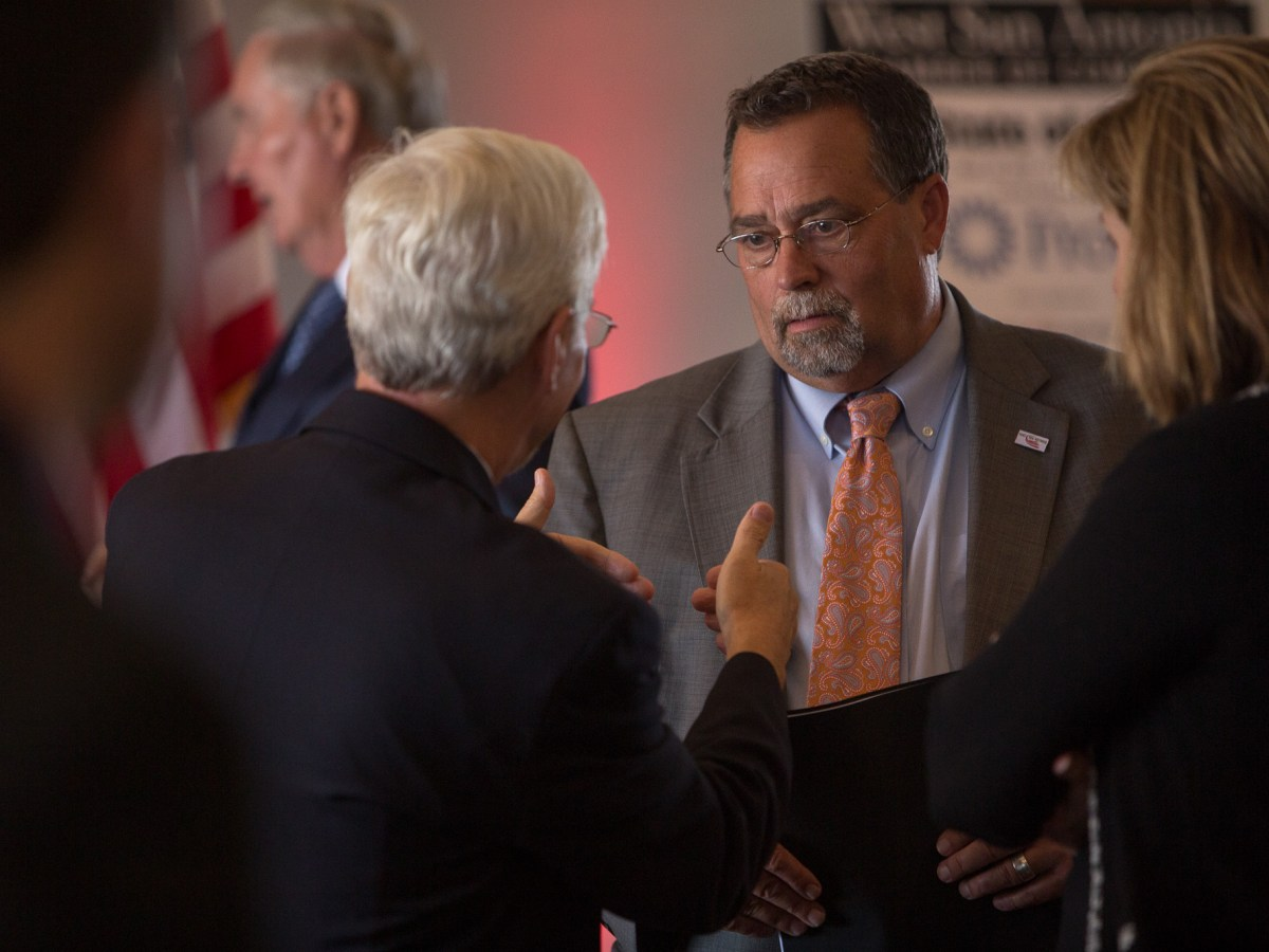 Port San Antonio President and CEO Roland Mower convenes with luncheon guests following the State of the Port address at the Plaza Club on Friday, September 22.